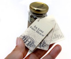The Little Folk's Delight | Bottle's tag close up